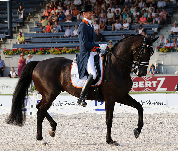 As the major championships for Europe, a serious demeanor is the order of the day. Not for Edward Gal on Glock's Undercover who clearly is enjoying every stride of their final centerline hat clinched the gold medal for the Netherlands in... of all places, Germany. © 2015 Ken Braddick/dressage-news.com