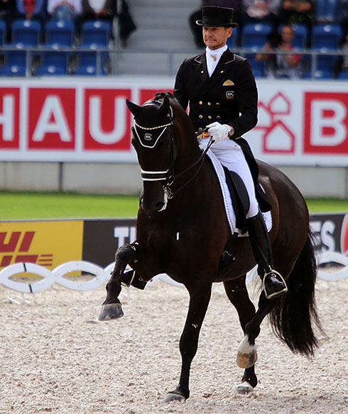 Edward Gal on an extremely tense Glock's Undercover at the beginning of their European Championship Grand Prix Special from which they were eliminated for blood on the horse's mouth. © 2015 Ken Braddick/dressage-news.com
