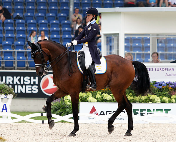 Championship team rookie Emilie Nyreröd on Miata, the top scoring Swedish pair on the first day of the Nations Cup. © 2015 Ken Braddick/dressage-news.com