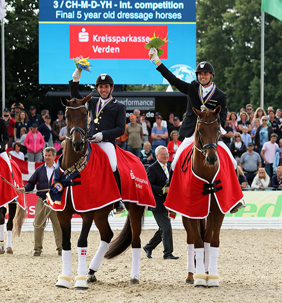 Fiontini with Juredo Severo aboard and Fiontina with Andreas Helgstrand with gold and silver medals at the World Young Horse Championships for five-year-olds. © 2015 Ken Braddick/dressage-news.com