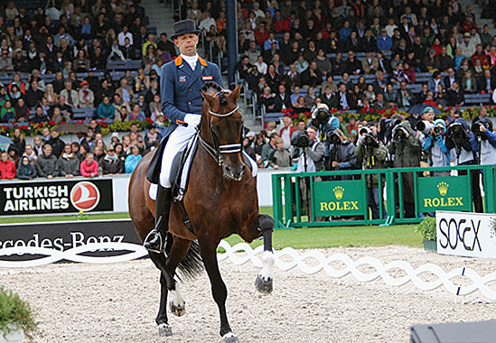 Hans Peter Minderhoud on Glock's Johnson with a phalanx of photographers close by to capture every movement. © 2015 Ken Braddick/dressage-news.com