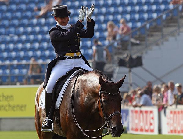Isabell Werth on Don Johnson FRH enjoying the applause from the European Championship crowd before she learned of her score. © 2015 Ken Braddick/dressage-news.com