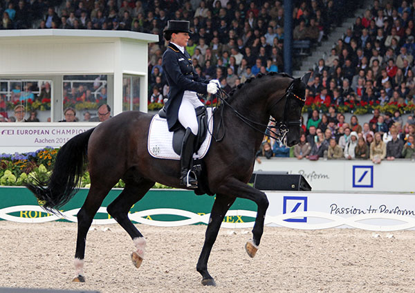 Kristina Bröring-Sprehe and Desperados FRH performing their best ever Grand Prix Freestyle to win the European Championship individual silver medal. © 2015 Ken Braddick/dressage-news.com