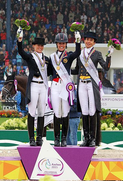 European Championship Grand Prix Freestyle medal winners Kristina Bröring-Sprehe (silver), Charlotte Dujardin (bronze) and Beatrix Ferrer-Salat (bronze). © 2015 Ken Braddick/dressage-news.com