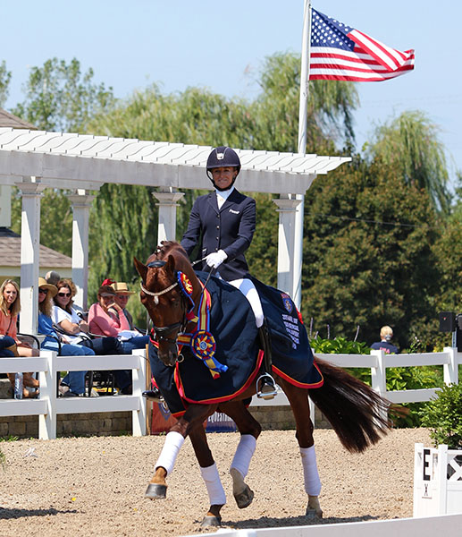 Lisa Wilcox on Gallant Reflection HU celebrating USA Six-Year-Old Championship. © 2015 Ken Braddick/dressage-news.com