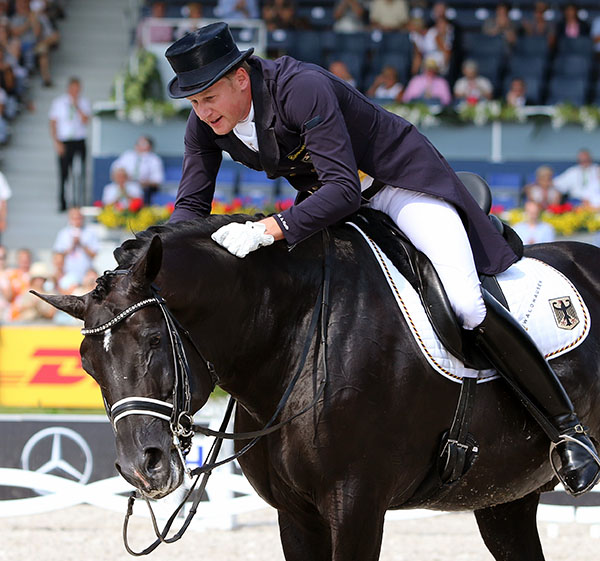 Totilas being steered by Matthias Alexander Rather out of a competition arena a final time, at the European Championships in Aachen, Germany. © 2015 Ken Braddick/dressage-news.com