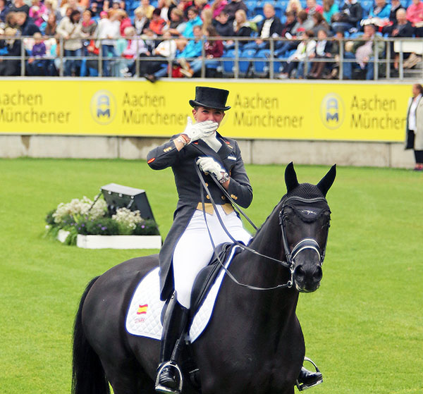Painted Black being ridden out of a competition arena fornthe last time by Morgan Barbançon Mestre of Spain. © 2015 Ken Braddick/dressage-news.com