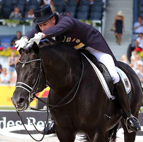Matthias Alexander Rath toying with Totilas apparently oblivious of the jeers during the pair's ride in the European Championships Grand Prix where the black stallion showed some irregularity. © 2015 Ken Braddick/dressage-news.com