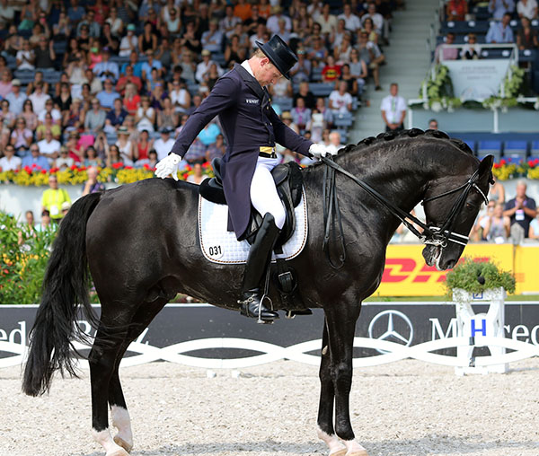 Matthias Alexander Rath and Totilas in what may have been the last salute in a competition arena, the European Championship Grand Prix, for the horse that revolutionized dressage. © 2015 Ken Braddick/dressage-news.com
