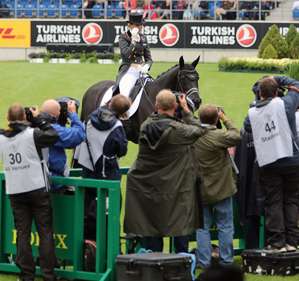 A tearful Morgan Barbançon Mestre of Spain riding Painted Black out of Aachen's Main Stadium at the European Championships, the last competition for the 18-year-old stallion. © 2015 Ken Braddick/dressage-news.com
