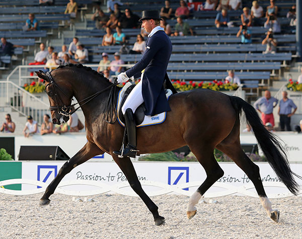 Patrik Kittel of Swedem on Deja, a combination making their championship debut but likely to be a fixture on the international circuit for the next several years. The Swedish Warmblood mare and Patrik began their Grand Prix career a couple of years ago but their 74.571 per cent helped Sweden to get 2016 Olympic team qualification. © 2015 Ken Braddick/dressage-news.com