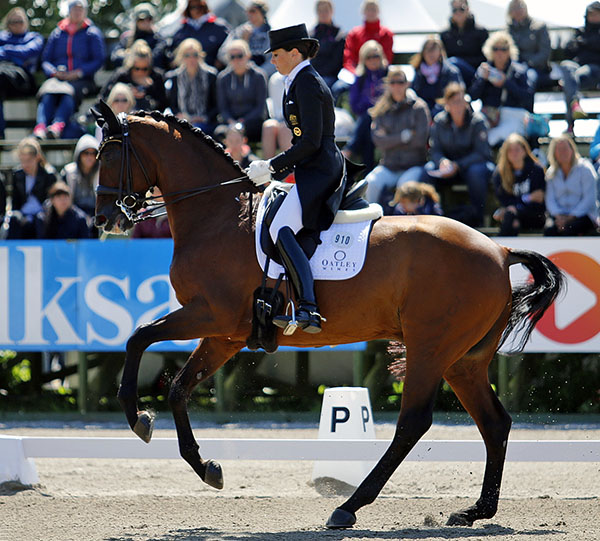 Lyndal Oatley on Sandro Boy competing in Europe this summer. © 2015 Kim C. Lundin