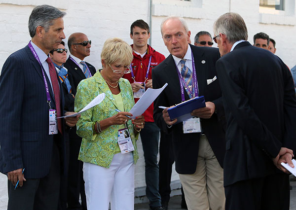 Katrina Wüst of Germany, president of the European Championships ground jury, discussing with Jean-Michel Roudier of France, a fellow judge, and veterinarians Dr. Hermann Josef Genn and Dr. Paul Farrington the veterinary check of Totilas. © 2015 Ken Braddick/dressage-news.com