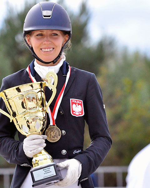 Anna Lukasik holding the Polish Championship trophy after repeating as winner on Stella Pack Ganda. © 2015 Julia Swietochowska Dressage24.pl