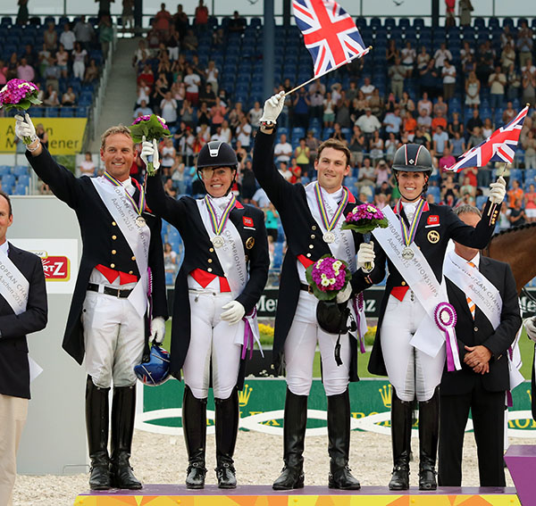 Great Britain's European Championship team of Carl Hester, Fiona Bigwood, Michael Eilberg and Charlotte Dujardin celebrating their silver medal. © 2015 Ken Braddick/dressage-news.com