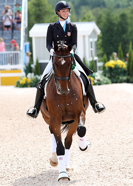 Laura Graves on Verdades at the Pan American Games where the pair won team gold and individual silver medals. © 2015 Ken Braddick/dressage-news.com