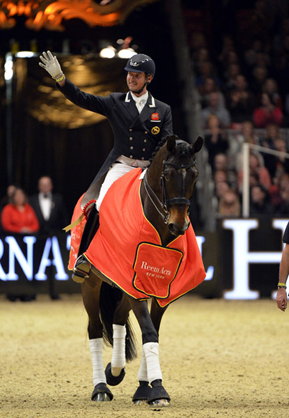 Carl Hester celebrating Olympia World Cup victory on Nip Tuck. © 2015 Kit Houghton/Hpower