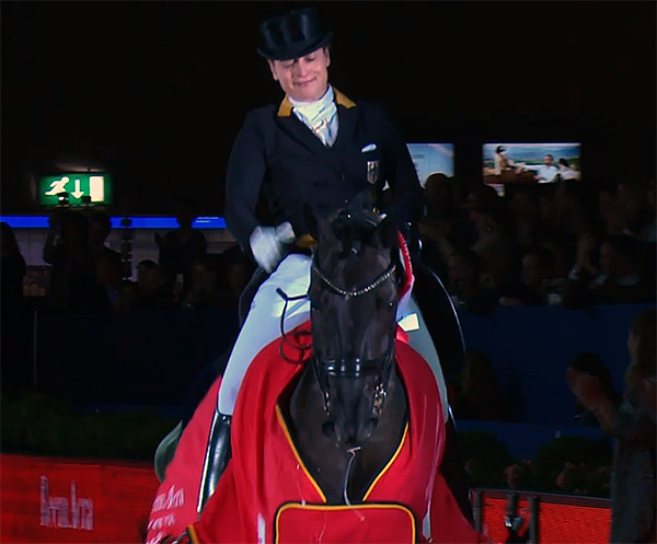Isabell Werth on Weihegold OLD celebrating victory at the World Cup Freestyle in Amsterdam.