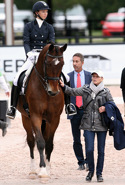 Debbie McDonald walking Laura Graves and Verdades to the competition arena with US coach Robert Dover. © 2016 Ken Braddick/dressage-news.com