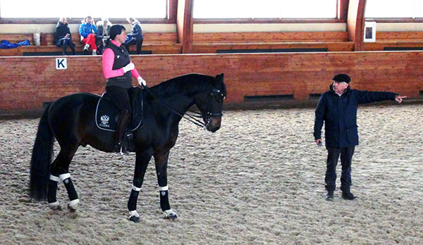 Inessa Merkulova on Mister X who appears to be receiving instructions from Ghislain Fouarge of the Netherlands in a photodated Oct. 22-24, 2015 and located by dressage-news.com on the Internet site of New Century stables, the facility owned by Inessa and her husband.