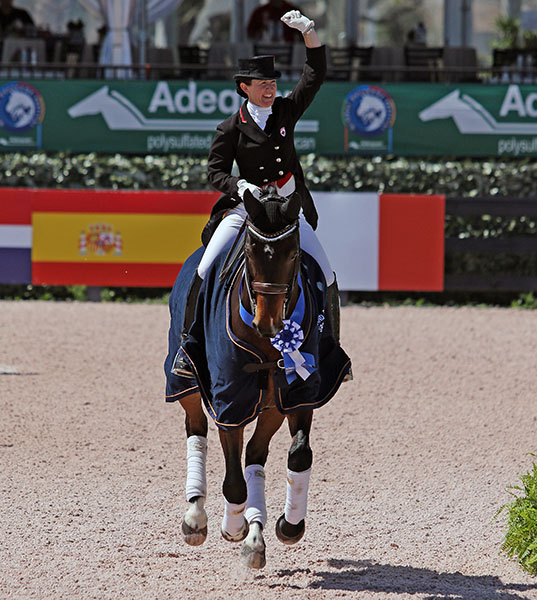 Belinda Trussell on Anton celebrating victory in the Adequan Global Dressage Festival World Cup Grand Prix Special, second win of the show. 2016 Ken Braddick/dressage-news.com