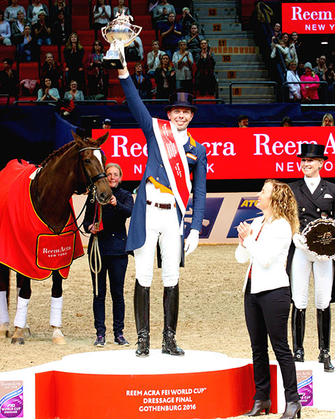 Hans Peter Minderhoud holding aloft the World Cup that the Dutch rider won on Glock's Flirt in Gothenburg, Sweden. © 2016 Pelle Wedenmark/dressage-news.com