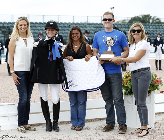 Felicitas Hendricks of Germany on her Faible AS won the Junior Rider championship in her second year competing in the event. Next to Felicitas is Jessica Newman, founder of JustWorld International that became a new partner in the championship. © 2016 SusanJStickle.com