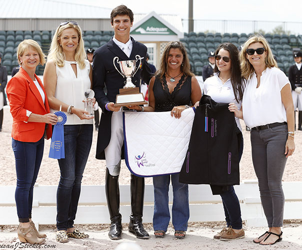 Juan Matute, Jr. of Spain rode Dhannie Ymas to the Young Rider title. Terri Kane (in red blouse) of Diamante Farm joined the lineup of sponsors in the photo. © 2016 SusanJStickle.com