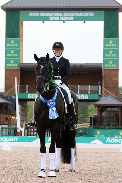 Ashley Holzer on Dressed in Black after winning the Grand Prix at the inaugural CDI3* at Tryon, North Carolina. © 2016 Ken Braddick/dressage-news.com