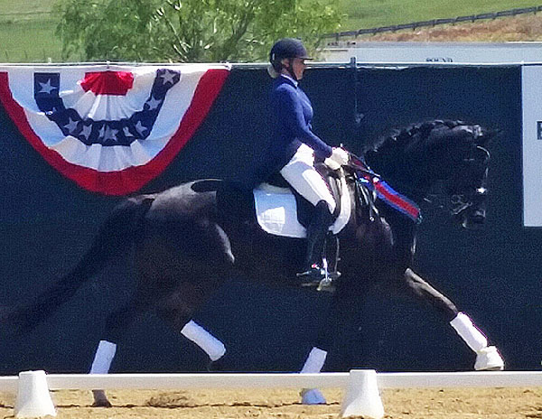 Emma Weinert O'Rourke celebrating their first Big Tour win in the San Juan Capistrano CDI3* Grand Prix Special. Photo Courtesy of Shannon Peters