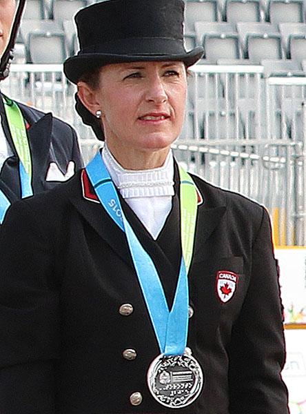 Belinda Trussell wearing Pan American Games silver medal. © 2015 Ken Braddick/dressage-news.com