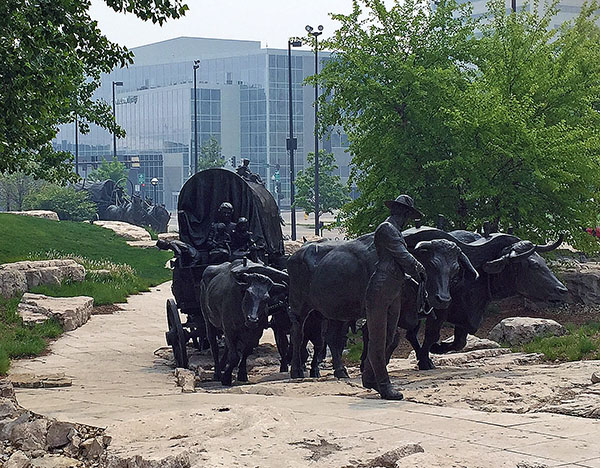 Life size bronzes of covered wagons in Omaha, Nebraska, host of the 2017 Wold Cup Finals of dressage and jumping. © 2016 Ken Braddick/dressage-news.com