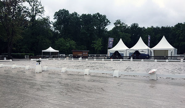 The rained out arena at the CDIO5* Nations Cup in Compiègne, France. © 2016 Lily Forado for dressage-news.com