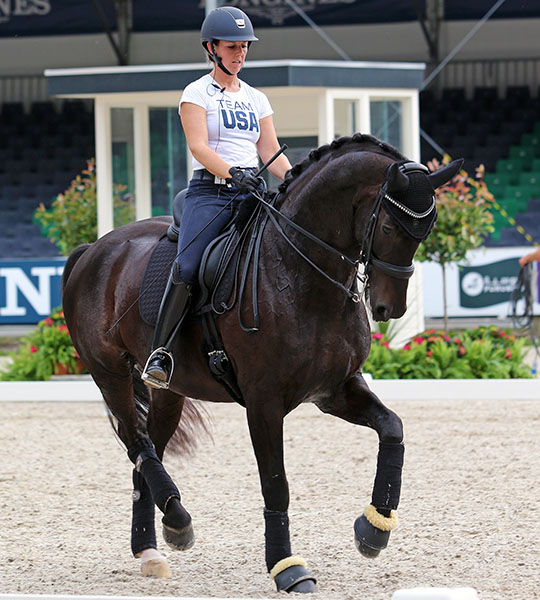 Kasey Perry-Glass working Dublet. Her t-shirt will be replaced by designer formal riding wear at the Olympics. © 2016 Ken Braddick/dressage-news.com