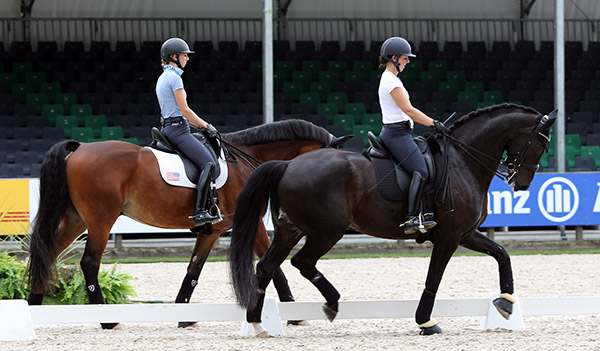 Kasey Perry-Glass on Dublet and Laura Graves on Verdades. The roles are the reverse of normal for the horses as Verdades has led the way in dealing with situations that Dublet has found scary. © 2016 Ken Braddick/dressage-news.com