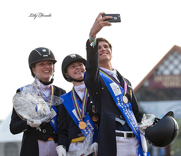 Selfie--maybe the image of the era-- Juan Matute ,Jr., bronze medalist, taking smartphone picture with gold medal winner Sanneke Rothenberger and silver medalist Florine Kienbaum on the individual Grand Prix medals podium at the European Under-25 Championships. © 2016 Lily  orado for dressage-news.com