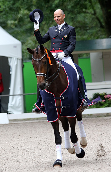 Steffen Peters on Rosamunde celebrating the pair's victory in the Rotterdam CDI3* Grand Prix Special. © 2016 Ken Braddick/dressage-news.com