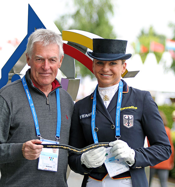 Dorothee Schneider with 80% Club brow band presented by Kenneth J, Braddick of dressage-news.com to recognize scoring 80 per cent in the Grand Prix that the German Olympian achieved at the Aachen, Germany CDIO5*. © 2016 Ilse Schwarz/dressage-news.com