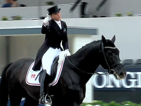 Thumbs up from Dorothee Schneider after riding Sezuan to victory in the preliminary test for the inaugural seven-year-old division at the World Young Horse Championships.