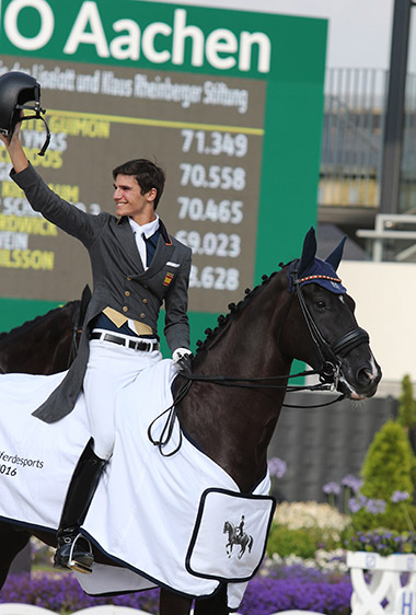 Juan Matute, Jr. on Quantico Ymas enjoying the applause after winning the Under-25 Grand Prix at the World Equestrian Festival in Aachen, Germany. © 2016 Ilse Schwarz/dressage-news.com