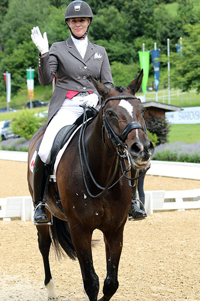 Karen Pavicic on Don Daiquiri leaving the arena after falling short of getting a score high enough in the Grand Prix Special to earn a start for Canada at the Olympics next month. © 2016 Ken Braddick/dressage-news.com