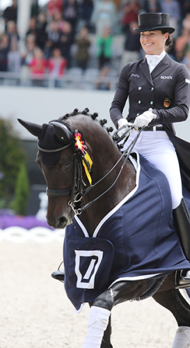 Kristina Bröring-Sprehe and Desperados enjoy the victory round© Ilse Schwarz/dressage-news.com