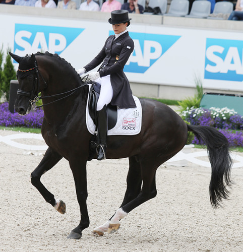 Kristina Bröring-Sprehe and Desperados pirouette to first place in the freestyle at Aachen, 2016©Ilse Schwarz/dressage-news.com