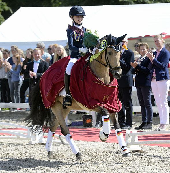 Germany's Lucie-Anouk Baumgürtel and Massimiliano celebrating European Pony Championships Freestyle victory. © 2016 Ridehesten.com