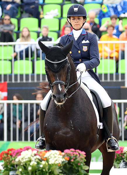 Allison Brock and Rosevelt focused on their ride on the USA team in the Olympic Grand Prix. Ali admitted she was enjoying the backgroud music so much she miscounted her one-tempi changes but turned in a performance that was tied for seventh after the first day. © 2016 Ken Braddick/dressage-news.com