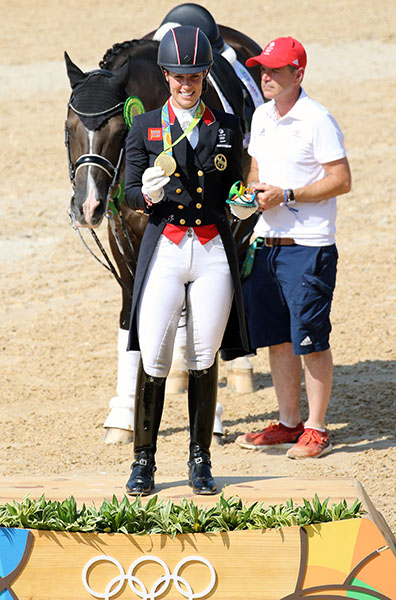 Charlotte Dujardin after winning the Olympic individual gold with Valegro minded by Alan Davies poking his nodse into the awards ceremony. © 2016 Ken Braddick/dressage-news.com