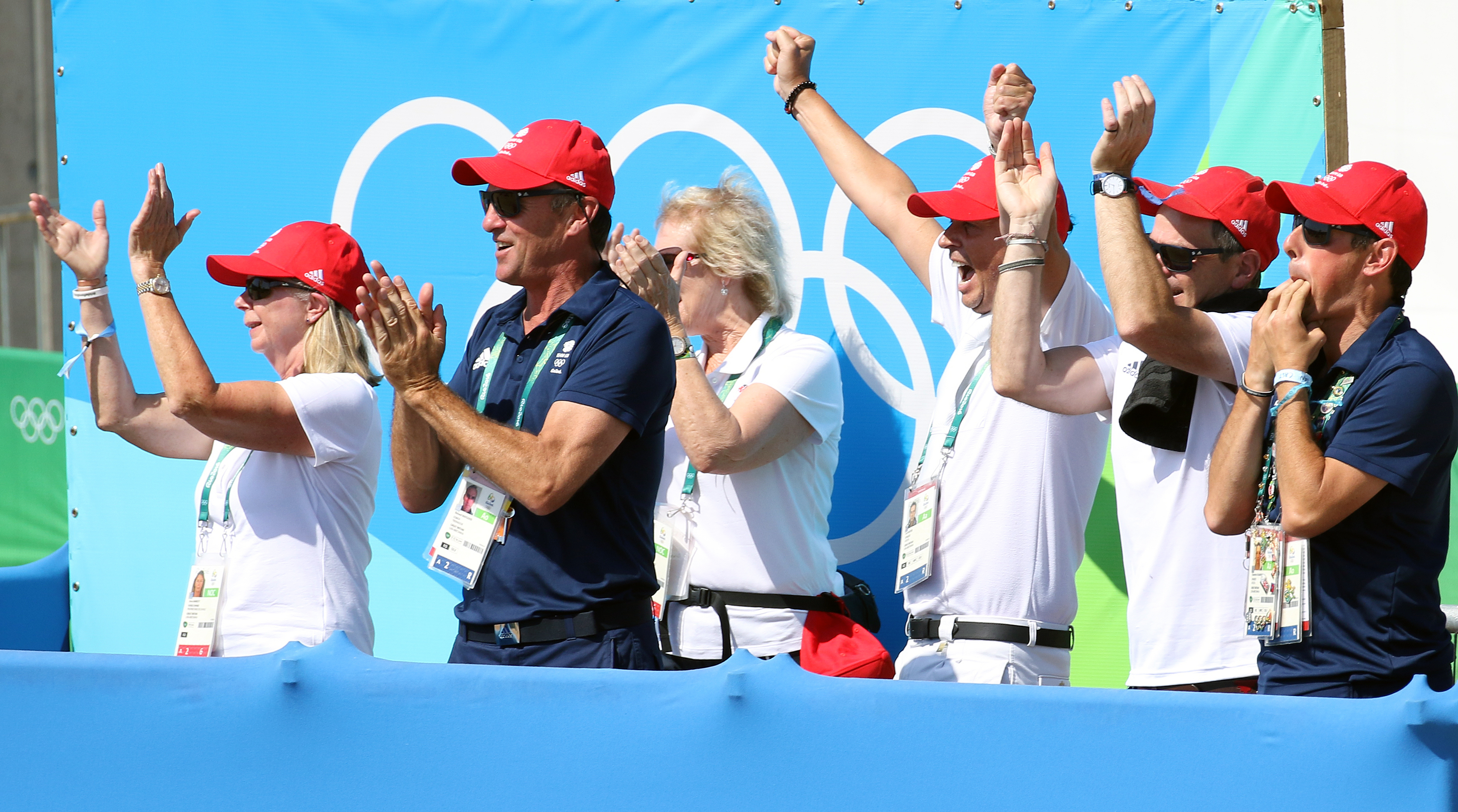 The Valegro/Charlotte Dujardin support group--Carl hester, part-owner, trainer and team mate is the one with hands held highest after the Grand Prix Freestyle to earn the British pair their second Olympic individual gold medal. © 2016 Ken Braddick/dressage-news.com