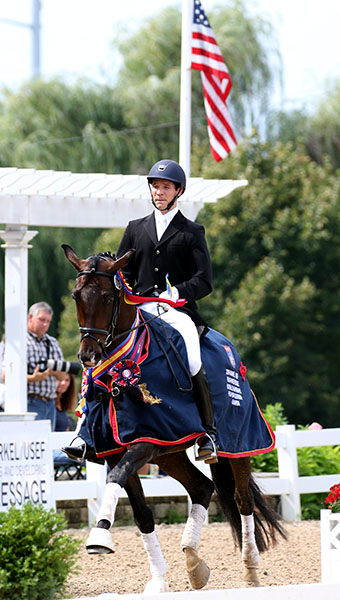 Christian Hartung on Desario leading the honor round as the USA Five-Year-Old Championship winners. © 2016 Ken Braddick/dressage-news.com