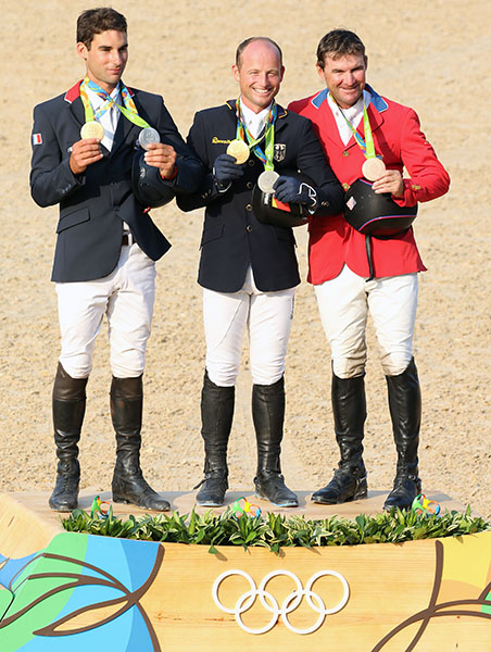 Michael Jung of Germany (individual god, team silver), Astier Nicolas of France (individual silver, team gold) and Phillip Dutton of the USA (individual bronze) at the Olympic medals ceremony. © 2016 Ken Braddick/dressage-news.com