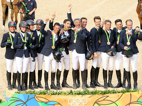 The France (gold), Germany (silver) and Australia (bronze) teams enjoying their time on the medals podium. © 2016 Ken Braddick/dressage=-news.com